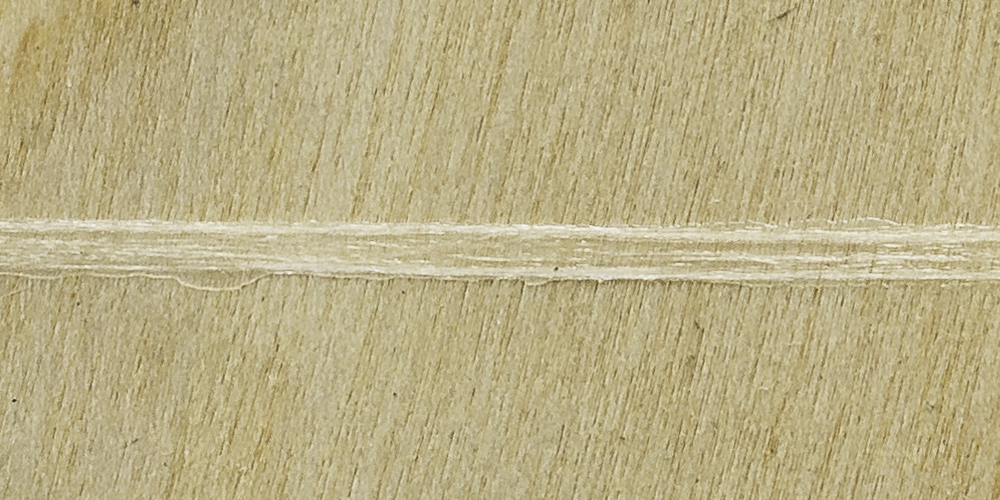 A sheet of wood with Lemtapes adhesive applied.