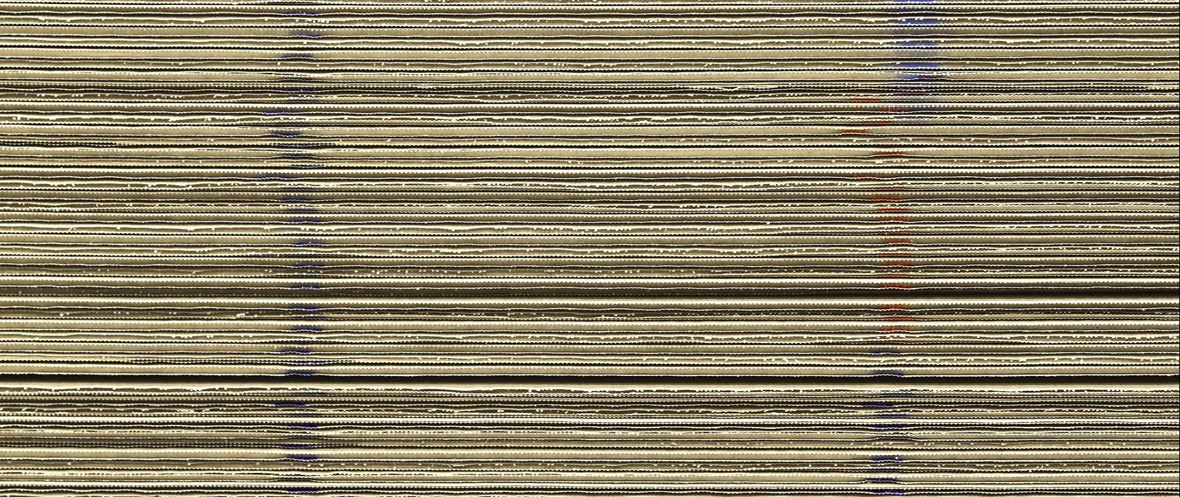 Stacked sheets of corrugated cardboard.