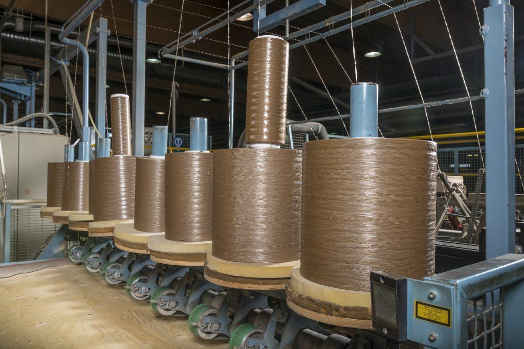 Rolls of core veneer in a factory.