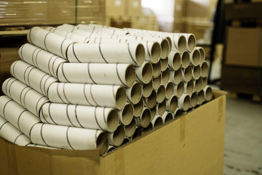 Leftover cardboard tubes ready for recycling.