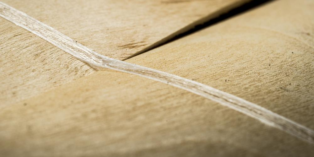 Two sheets of wood with Lemtapes adhesive laid across.