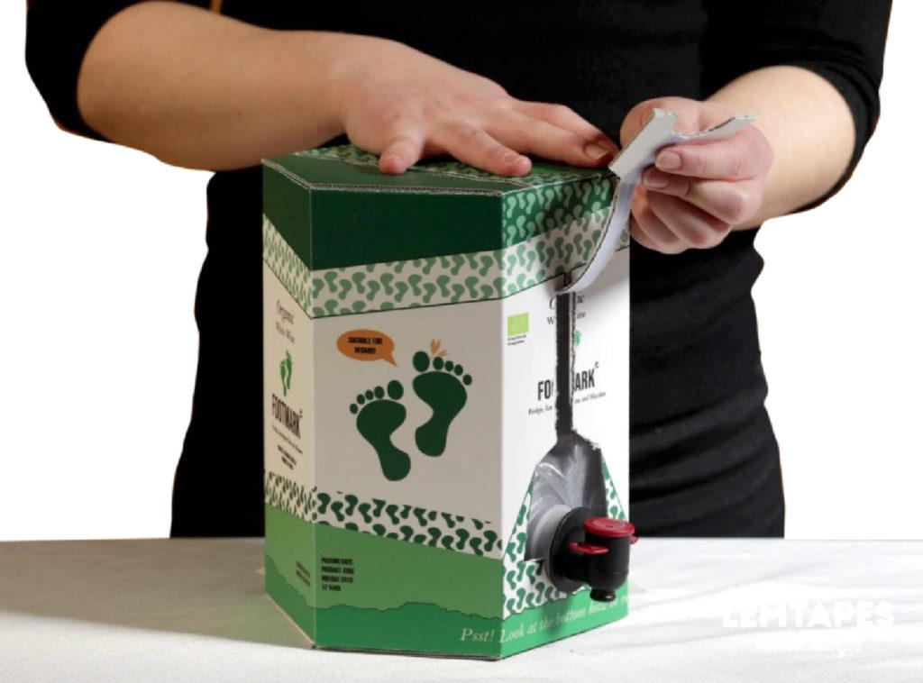 Demonstrating the easy-open functionality of Lemtapes Bag In Box.